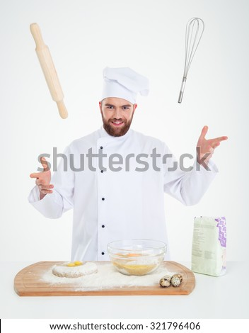 Portrait of a happy male chef cook baking isolated on a white background - stock photo