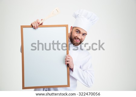 Portrait of a happy male chef cook holding blank board isolated on a white background - stock photo