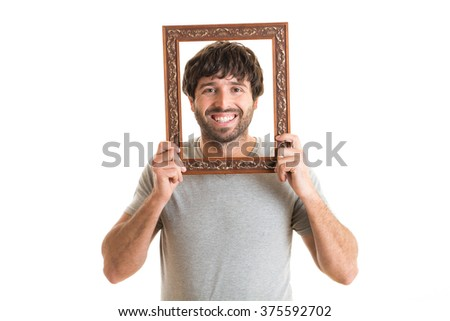 Portrait of a happy man holding picture frame