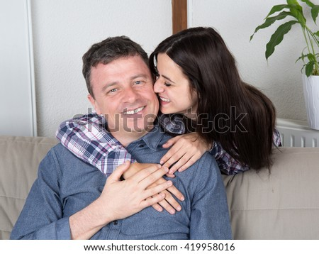 Portrait of a happy man smiling with young woman - stock photo