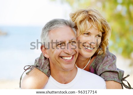 Portrait of a happy mature couple outdoors - stock photo
