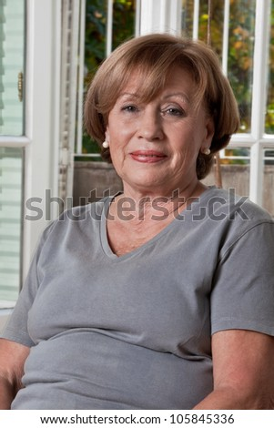 Portrait of a happy mature woman. - stock photo
