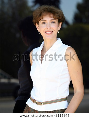 Portrait of a happy mature woman smiling - stock photo