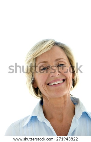 Portrait of a happy mature woman - white background with copy space - stock photo