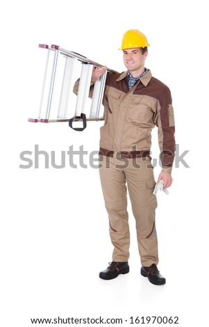 Portrait Of A Happy Mechanic With Ladder Over White Background - stock photo