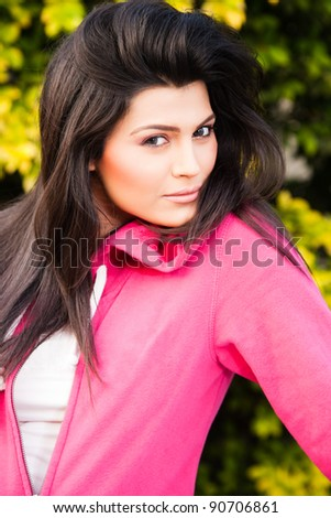 portrait of a happy mixed race woman in outdoor - stock photo