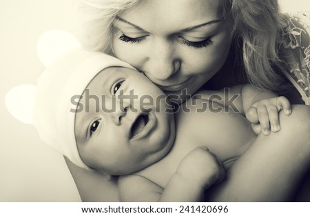 Portrait of a happy mother and cute baby - stock photo