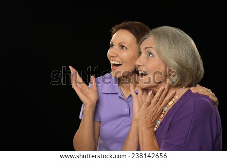 Portrait of a happy mother and daughter surprised - stock photo