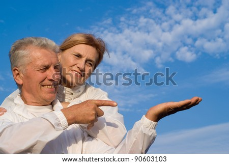 portrait of a happy old couple at sky - stock photo