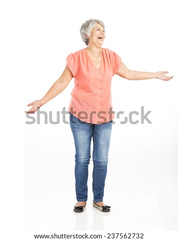 Portrait of a happy old woman with both arms open, with copyspace for the designer - stock photo