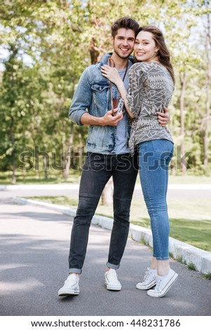 Portrait of a happy romantic couple having date outdoors in the park