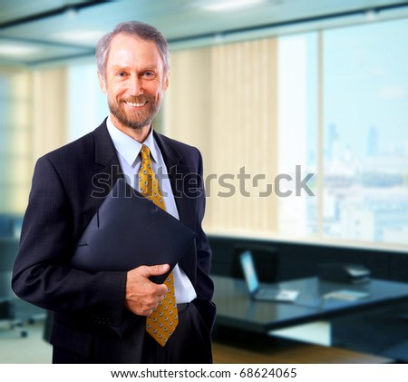 Portrait of a happy senior business man smiling - stock photo