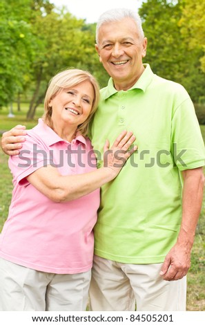 Portrait of a happy senior couple in the park. - stock photo