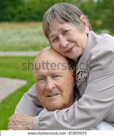 Portrait of a happy senior man and  woman - stock photo