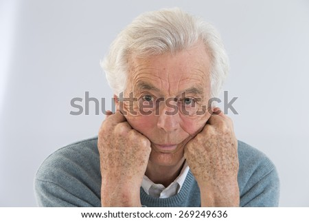 Portrait of a happy senior man isolated - stock photo