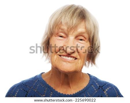 Portrait of a happy senior woman against white  - stock photo