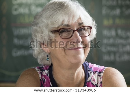 Portrait of a happy senior woman in a cafe, close up - stock photo