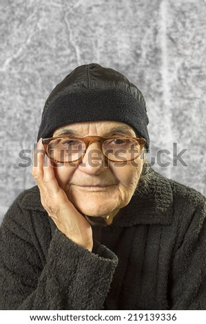 Portrait of a happy senior woman smiling at the camera. - stock photo