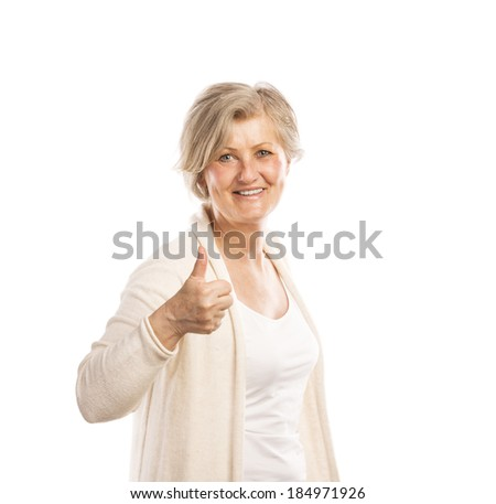 Portrait of a happy senior womanwith thumbs up isolated on white background - stock photo