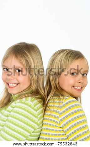 portrait of a happy sisters on white - stock photo