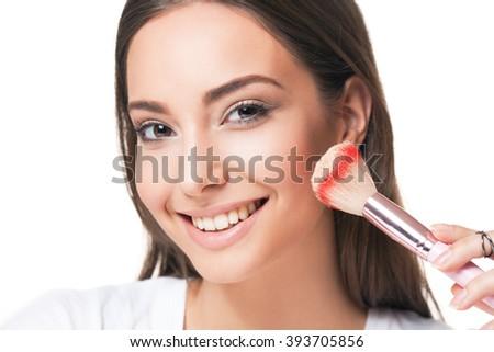 Portrait of a happy smiling brunette makeup beauty. - stock photo