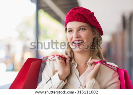 Portrait of a happy smiling woman with shopping bags at the mall