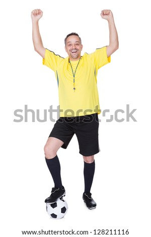 Portrait Of A Happy Soccer Player With A Football Against White Background