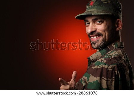 Portrait of a happy soldier over red and black background