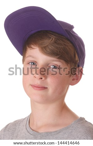 Portrait of a happy teenage boy with cap on white background - stock photo