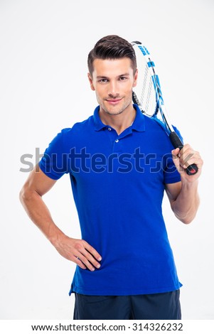Portrait of a happy tennis player standing isolated on a white background - stock photo