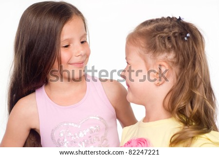 portrait of a happy two sisters on white - stock photo