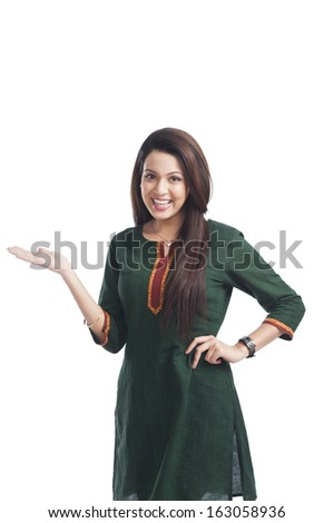 Portrait of a happy woman gesturing - stock photo