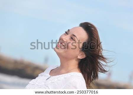 portrait of a happy woman outdoors - stock photo