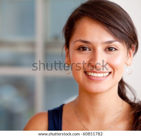 Portrait of a happy woman smiling - indoors - stock photo