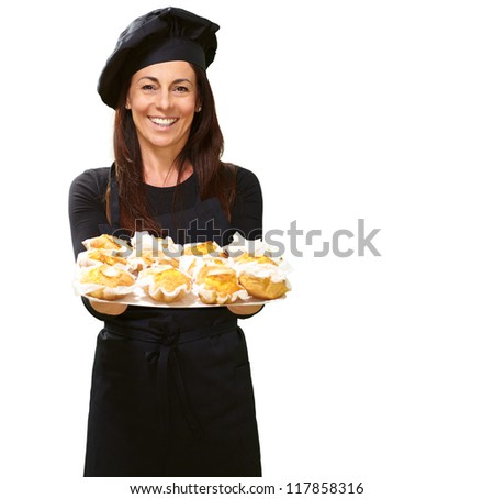 Portrait Of A Happy Woman While Holding Cupcake On White Background - stock photo