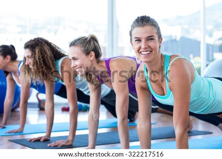 Portrait of a happy woman with friends in fitness studioPortrait of a happy woman with friends in fitness studio