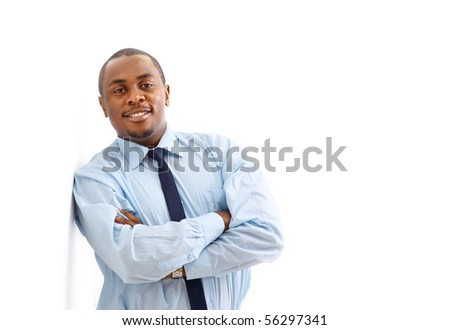 Portrait of a happy young African American business man with hands folded on white - stock photo