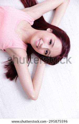 portrait of a Happy young beautiful woman relax lying and smile to you, great for your design, asian beauty - stock photo