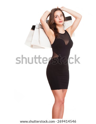 Portrait of a happy young brunette beauty with shopping bags. - stock photo