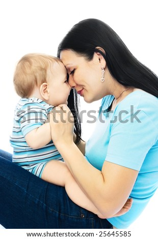 portrait of a happy young brunette woman with her ten months old son - stock photo
