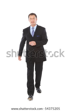 Portrait of a happy young business man carrying a suitcase on white background - stock photo