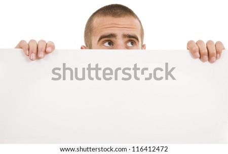 Portrait of a happy young business man holding a blank billboard - stock photo