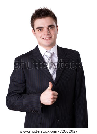 Portrait of a happy young business man showing thumbs up sign against white background
