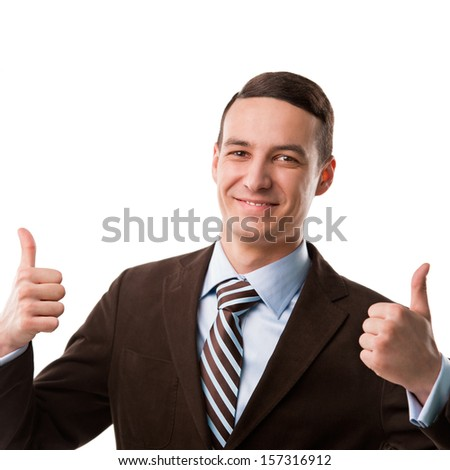 Portrait of a happy young business man showing thumbs up sign with two hands over white background - stock photo