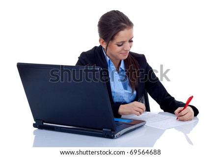 Portrait of a happy young business woman at the office desk writing against white background - stock photo