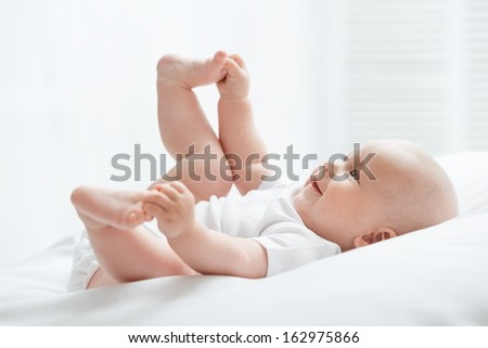 Portrait of a happy young child - stock photo