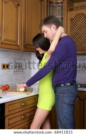 Portrait of a happy young couple preparing healthy food together at home - stock photo