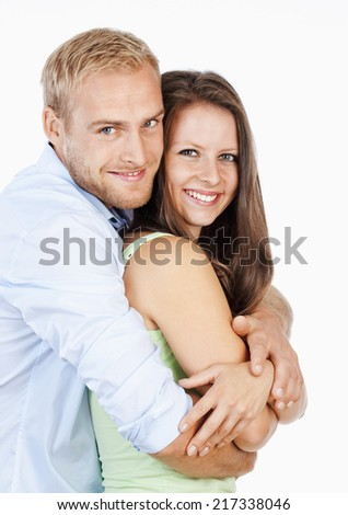 Portrait of a Happy Young Couple Smiling Looking - Isolated on White - stock photo