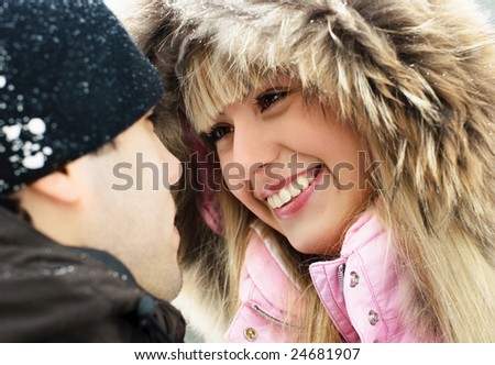 portrait of a happy young couple talking and smiling outdoor - stock photo