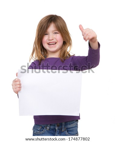 Portrait of a happy young girl holding a blank poster with thumbs up gesture - stock photo